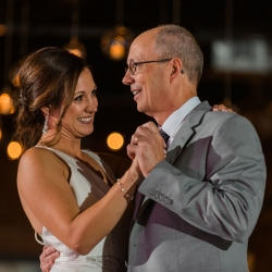 Bride shares a dance with her father to music provided by Carolina DJ Professionals during her reception at Triple C Barrel Room