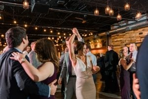 Bride and groom dance to music provided by Carolina DJ Professionals during their fall wedding at Triple C Barrel Room