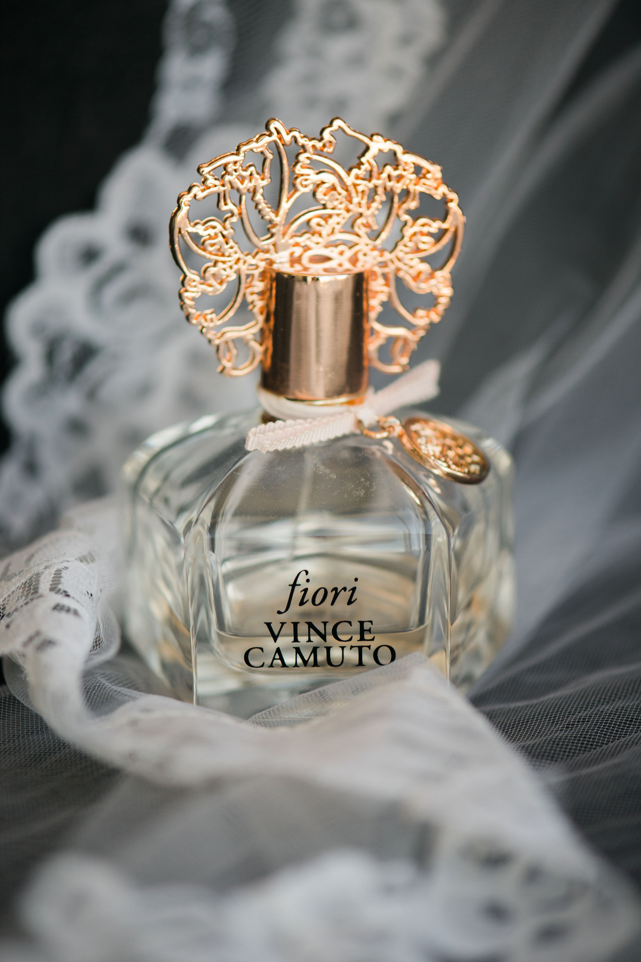 Detail shot of bridal veil and perfume captured by Sunshower Photography for a fall wedding at Triple C Barrel Room