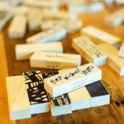 Guests enjoyed games during a wedding at The Westin Uptown including this Jenga game complete with sweet messages to the bride and groom