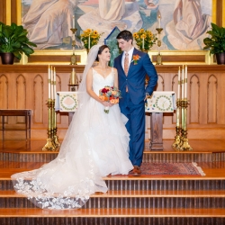 Bride and groom share a smile after their wedding ceremony at St. Peter's Catholic Church