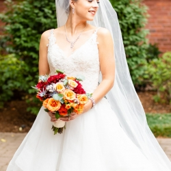 Taylor Main Photography captures a stunning bride after her wedding ceremony at St Peter's Catholic Church