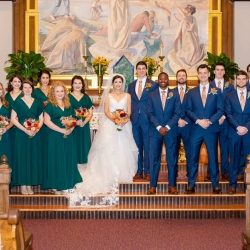 Taylor Main Photography captures a bridal party after their wedding ceremony at St Peter's Catholic Church