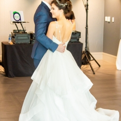 Bride and groom share a romantic first dance to music provided by DJ Rock-cee Entertainment during their uptown Charlotte wedding