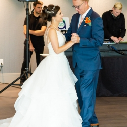 Bride shares a dance with her father during her wedding reception coordinated by Magnificent Moments Weddings at The Westin