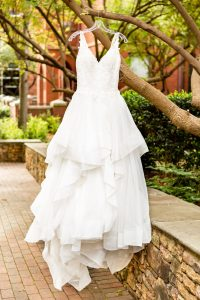 Taylor Main photography captures a brides gown among the trees of The Green during her Uptown Charlotte wedding