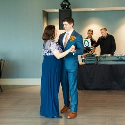 Groom shares a dance with his mother during his uptown Charlotte wedding captured by Taylor Main Photography
