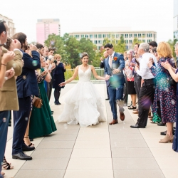 Bride and groom exit their wedding reception coordinated by Magnificent Moments Weddings through a bubble send off