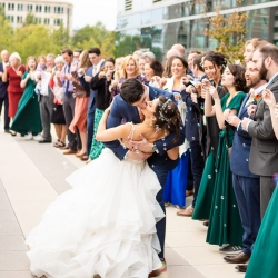 Bride and groom share a kiss amid their bubble send off following their wedding at The Westin in Uptown Charlotte