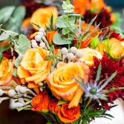 Deep orange and red colors are the perfect fall accents created by Magnificent Moments Weddings