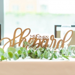 Custom wood sign dons the sweetheart table during a fall wedding at The Westin