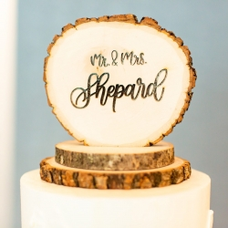 Custom wooden cake topper shows off the couples last name during a fall wedding in Uptown Charlotte