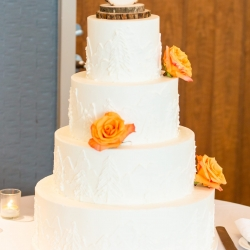 Stunning four tiered cake topped with a rustic topper was the perfect treat for a fall wedding at The Westin