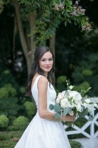 Bride holds a stunning New Creations bouquet before her wedding at The Duke Mansion