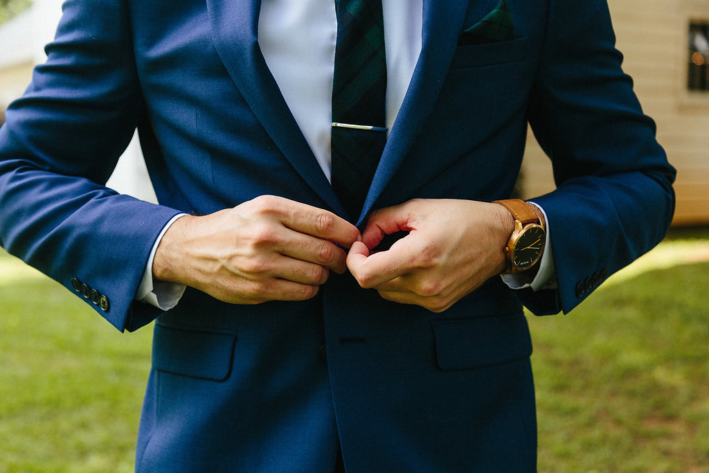 Detail shot of grooms suit during a spring wedding at The Dairy Barn coordinated by Magnificent Moments Weddings and captured by Alivia Photography