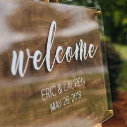 Sign welcoming guests to a spring wedding at the Diary Barn captured by Alivia Photography