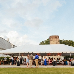 The Diary Barn in Forth Mill South Carolina creates the perfect setting for an outdoor wedding reception under a tent during a spring event coordinated by Magnificent Moments Weddings
