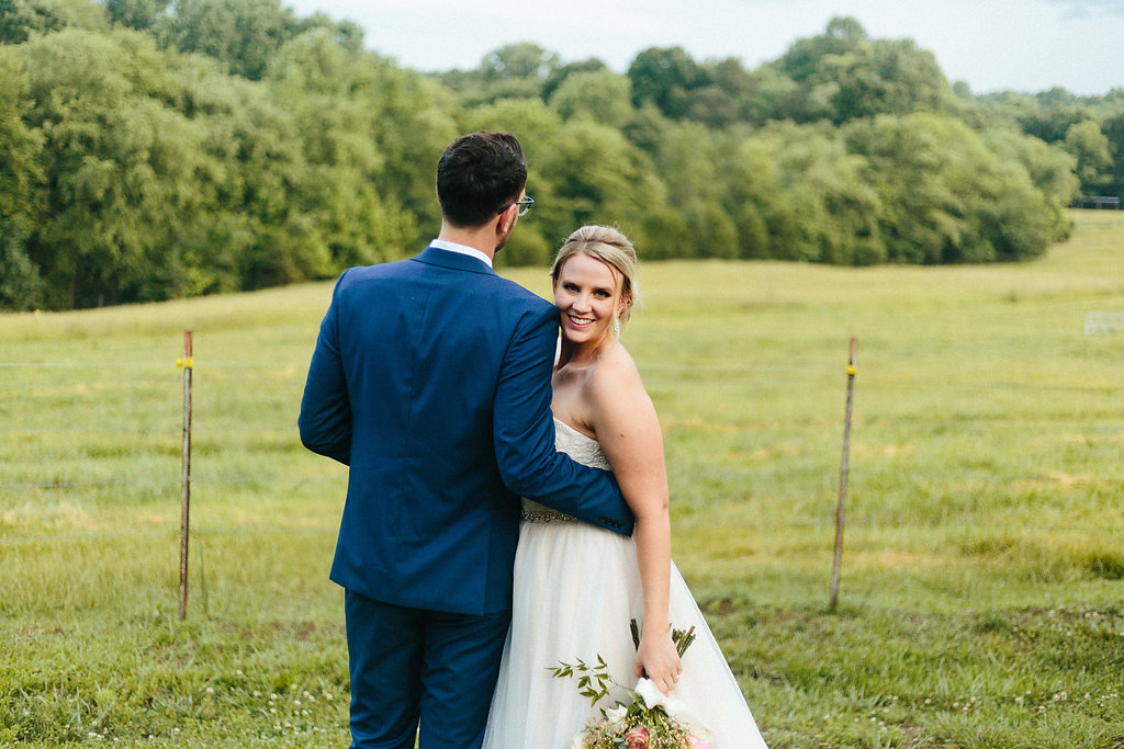 Bride and groom pose for Alivia Photography during their Fort Mill South Carolina spring wedding