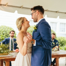 Bride and groom share a first dance played by Split Second Sound during their spring wedding reception at The Diary Barn coordinated by Magnificent Moments Weddings