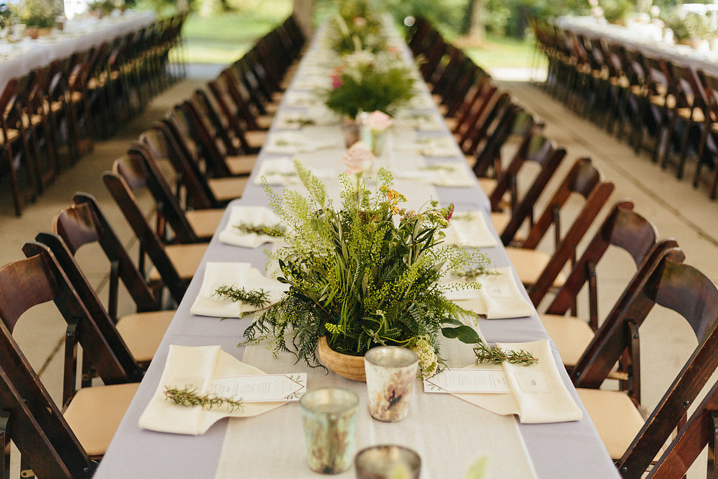 Pale blue linens and dark wood chairs from creative solutions create an organic spring wedding at The Diary Barn