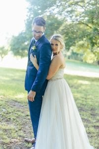 Bride and groom embrace at The Diary Barn in Fort Mill South Carolina before their wedding ceremony coordinated by Magnificent Moments Weddings