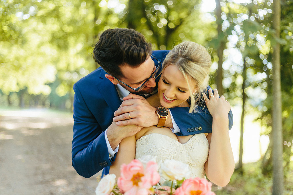 Bride and groom embrace during their spring wedding at Their Dairy Barn captured by Alivia Photography
