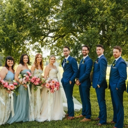 Bride and groom pose with bridal party at their spring Dairy Barn wedding in Fort Mill South Carolina