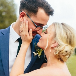 Alivia Photography captures and bride and groom kissing during their spring wedding coordinated by Magnificent Moments Weddings