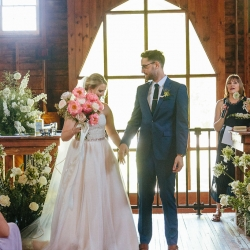 Bride and groom exit their Dairy Barn ceremony in a stunning photo captured by Alivia Photography