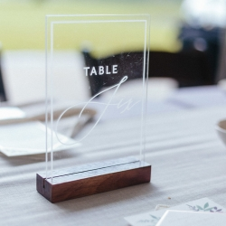 Etch glass table numbers mark seats for guests at a spring wedding at The Diary Barn captured by Alivia Photography