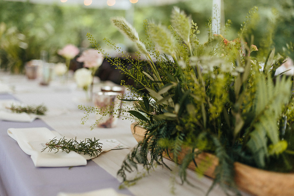 Green centerpieces set on pale blue linens create an organic feel at a spring wedding in Fort Mill South Carolina