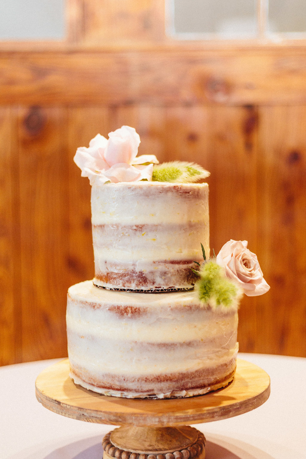 Simple two layer cake served at a spring wedding reception at The Diary Barn in Fort Mill South Carolina