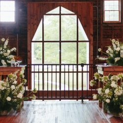 Ceremony space anchored by floral centerpieces designed by Nkemdi Thompson for a Dairy Barn Wedding