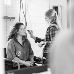 Cotton Rouge puts the final hair and make up touches on a bride during her fall wedding at The Diary Barn