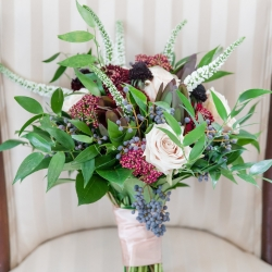 Buy the Bunch created a beautiful bridal bouquet that feature dark burgundy and soft pink flowers