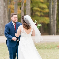 Bride and groom share a romantic first look on the grounds of the Diary Barn before their wedding cermeony