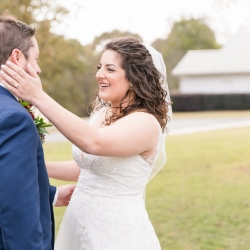 Bride and groom embrace during their first look coordinated by Magnificent Moments Weddings