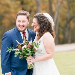 Bride and groom share a laugh before saying I Do during their wedding coordinated by Magnificent Moments Weddings