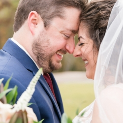Jenny Williams Photography captures a sweet moment between a bride and groom during their fall wedding in Fort Mill, South Carolina