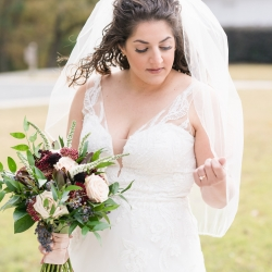 Jenny Williams Photography captures a bride holding her hand tied bouquet created by Buy the Bunch for her fall wedding at The Diary Barn