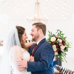 Bride and groom share a moment in their reception space before the party captured by Jenny Williams Photography