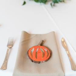 Beige napkins and a cute pumpkin cut out are the perfect touches that reflect the brides style during her wedding at The Diary Barn