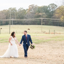 Bride and groom walk the grounds of the Dairy Barn before walking down the aisle