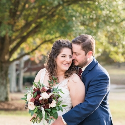 Jenny Williams Photography captures a sweet moment between a bride and groom before their wedding ceremony at The Diary Barn