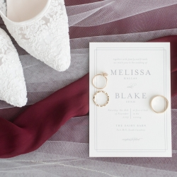 Jenny Williams Photography captures wedding details including invitation and bridal shoes for a fall wedding at The Diary Barn