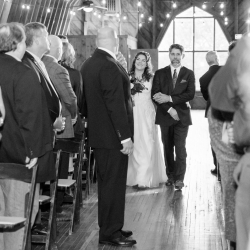 Brides is escorted down the aisle to her wedding ceremony captured by Jenny Williams Photography
