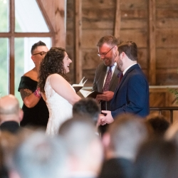 Bride shares a laugh during her wedding ceremony coordinated by Magnificent Moments Weddings