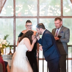 Bride and groom share in communion during their wedding ceremony captured by Jenny Williams Photography