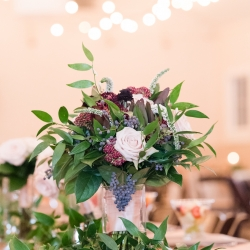 Stunning bridal bouquet features soft pink and deep purple flowers created by Buy the Bunch