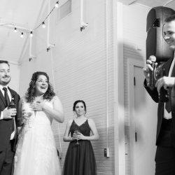 Jenny Williams Photography captures a fun moment as the bride and groom are toasted during their wedding coordinated by Magnificent Moments Weddings